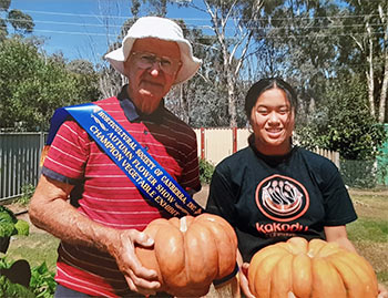 Reginald and Olivia with the prize pumpkin