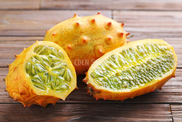cucumber african horned kiwano cut open on table